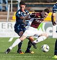 Forfar's James Dale and Stenny's Sean Dickson challenge for the ball.