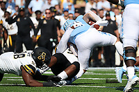 CHAPEL HILL, NC - SEPTEMBER 21: Jace Ruder #10  of the University of North Carolina is injured while being sacked by Elija Diarrassouba #57 and E.J. Scott #98 of Appalachian State University during a game between Appalachian State University and University of North Carolina at Kenan Memorial Stadium on September 21, 2019 in Chapel Hill, North Carolina.
