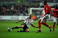 ATTENTION SPORTS PICTURE DESK<br /> Pictured: Darren Pratley of Swansea (L) challenges Jonas Olsson of West Bromwich Albion (R)<br /> Re: Coca Cola Championship, Swansea City Football Club v West Bromwich Albion at the Liberty Stadium, Swansea, south Wales. Tuesday 16 March 2010