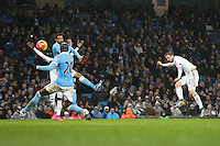 Gylfi Sigurdsson scores a goal but it is disallowed for a foul on Joe Hart during the Barclays Premier League Match between Manchester City and Swansea City played at the Etihad Stadium, Manchester on 12th December 2015