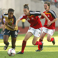 Coquimbo, Chile: American's player Nikki Washington (L) dispute the ball with germany´s player Verena Faisst during the semi-final match in the Fifa U-20 Women´s World Cup at Francisco Sanchez Rumoroso stadium in Coquimbo, located at 459 kilometers north of Santiago, on December 4 th, 2008. By Grosnia / ISIphotos.com