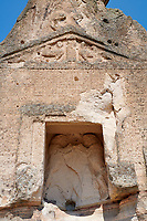 close up of the facade and relief sculptures of the Phrygian temple of Aslankaya, 7th century BC. Phyrigian Valley, Emre Lake, near Döğer, Turkey.<br /> <br /> <br /> On the triangular roof over the facade are two sphinxes (winged figures with the head of a human and the body of a lion), facing one another, take place. In the main facade, below, the sphinxes in a niche, a cult statue of Kybele or the Great Mother (vandalised and destroyed) was flanked by two lions. This main facade is ornamented with relief geometrical patterns.