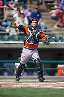 Frederick Keys catcher Steel Russell (52) makes a throw to first base against the Lynchburg Hillcats at Calvin Falwell Field at Lynchburg City Stadium on May 14, 2015 in Lynchburg, Virginia.  The Hillcats defeated the Keys 6-3.  (Brian Westerholt/Four Seam Images)