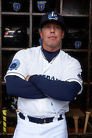 Lake County Captains manager Shaun Larkin (4) poses for a photo before a game against the Fort Wayne TinCaps on May 20, 2015 at Classic Park in Eastlake, Ohio.  Lake County defeated Fort Wayne 4-3.  (Mike Janes/Four Seam Images)