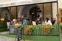 Restaurant in town square center with tourists in Cesky Krumlov in Czech Republic