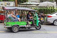 Bangkok, Thailand.  Tuk-tuk, a Three-wheeled Motorcycle Taxi.