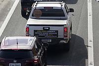 Campinas (SP), 21/01/2021 - Protesto/ICMS - Protesto de revendedores de veiculos de Campinas e regiao, nesta quinta-feira (21), lojistas sairam em carreata pelas ruas da cidade de Campinas (SP), em repudio ao aumento de 207% na aliquota do Imposto sobre Circulacao de Mercadorias e Servicos (ICMS) sobre a compra e venda de veiculos usados. O movimento na rodovia Anhanguera ficou lento. (Foto: Denny Cesare/Codigo 19/Codigo 19)