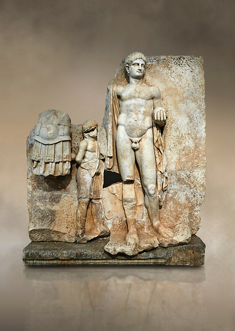 Roman Sebasteion relief  sculpture of Emperor Nero with captive, Aphrodisias Museum, Aphrodisias, Turkey.  Against an art background.<br /> <br /> Naked warrior emperor Nero holds the orb of world rule in one hand and crowns the military trophy with the other. Between the trophy and the emperor stands a bound captive boy. He wears long barbarian trousers and looks up at Nero.