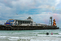 BNPS.co.uk (01202 558833)<br /> Pic: Graham Hunt/BNPS<br /> Date: 2nd September 2021.<br /> <br /> The Red arrows performing their display above the pier on day 1 of Bournemouth Air Festival in Dorset on a warm overcast day.