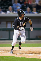 Drew Carcia (12) of the Charlotte Knights hustles down the first base line against the Toledo Mud Hens at BB&T BallPark on April 27, 2015 in Charlotte, North Carolina.  The Knights defeated the Mud Hens 7-6 in 10 innings.   (Brian Westerholt/Four Seam Images)