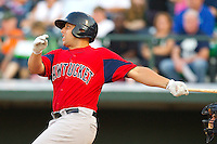 Luis Exposito #34 of the Pawtucket Red Sox follows through on his swing against the Charlotte Knights at Knights Stadium on August 11, 2011 in Fort Mill, South Carolina.  The Red Sox defeated the Knights 3-2.   (Brian Westerholt / Four Seam Images)