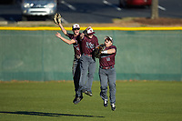 (L-R) Concord Mountain Lions outfielders Ryan Fralin (28), Brandon Bayne (8), and Richard Ortiz (16) celebrate after their win over the Wingate Bulldogs at Ron Christopher Stadium on February 2, 2020 in Wingate, North Carolina. The Mountain Lions defeated the Bulldogs 12-11. (Brian Westerholt/Four Seam Images)