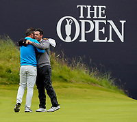 190719 | The 148th Open - Day 2<br /> <br /> Paul Casey of England hugs Rory McIlroy of Northern Ireland after the 2nd round in the 148th Open Championship at Royal Portrush Golf Club, County Antrim, Northern Ireland. Photo by John Dickson - DICKSONDIGITAL