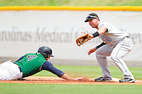 Chris Marrero #30 of the Syracuse Chiefs catches a pick-off attempt as Donny Lucy #4 of the Charlotte Knights dives back to first base at Knights Stadium on June 19, 2011 in Fort Mill, South Carolina.  The Knights defeated the Chiefs 10-9.    (Brian Westerholt / Four Seam Images)