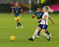 ORLANDO, FL - JANUARY 22: Julie Ertz #8 passes the ball away from Catalina Usme #11 during a game between Colombia and USWNT at Exploria stadium on January 22, 2021 in Orlando, Florida.