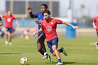 BRADENTON, FL - JANUARY 23: Andres Perea, Sebastian Lletget battle for a ball during a training session at IMG Academy on January 23, 2021 in Bradenton, Florida.