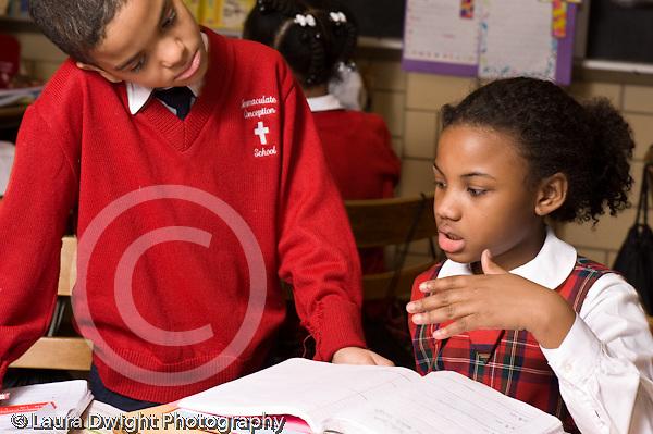 K-8 Parochial School Bronx New York Grade 3 mathematics lesson on measurement using rulers boy and girl working together horizontal