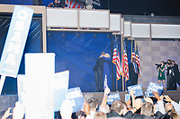 President Barack Obama and current Democratic nominee for president Hillary Clinton embrace and wave to the crowd after Obama spoke at the Democratic National Convention at the Wells Fargo Center in Philadelphia, Pennsylvania, on Wed., July 27, 2016.