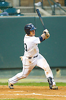 Larry Gonzalez #23 of the Pulaski Mariners follows through on his swing against the Greeneville Astros at Calfee Park August 29, 2010, in Pulaski, Virginia.  Photo by Brian Westerholt / Four Seam Images