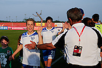 Kelley O'Hara (19) of the Boston Breakers high fives head coach Tony DiCicco prior to playing Sky Blue FC. Sky Blue FC defeated the Boston Breakers 2-1 during a Women's Professional Soccer (WPS) match at Yurcak Field in Piscataway, NJ, on May 28, 2011.