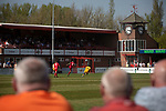 Home supporters watching the first-half action as Ilkeston Town (in red) host Walsall Wood in a Midland Football League premier division match at the New Manor Ground, Ilkeston. The home team were formed in 2017 taking the place of Ilkeston FC which had been wound up earlier that year. Watched by a crowd of 1587, their highest of the season, the match was top versus second, however, the visitors won 4-0 and replaced their hosts at the top of the division on goal difference with two matches to play