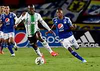 BOGOTA - COLOMBIA, 31-10-2020: Emerson Rodriguez de Millonarios F. C. y Helibelton Palacios de Atletico Nacional disputan el balon, durante partido entre Millonarios F. C. y Atletico Nacional de la fecha 17 por la Liga BetPlay DIMAYOR 2020 jugado en el estadio Nemesio Camacho El Campin de la ciudad de Bogota. / Emerson Rodriguez of Millonarios F. C. and Helibelton Palacios of Atletico Nacional figth for the ball, during a match between Millonarios F. C. and Atletico Nacional of the 17th date for the BetPlay DIMAYOR League 2020 played at the Nemesio Camacho El Campin Stadium in Bogota city. / Photo: VizzorImage / Luis Ramirez / Staff.