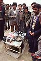 Iran 1981.On the road between Sar Dasht and Piranshar, men selling bullets