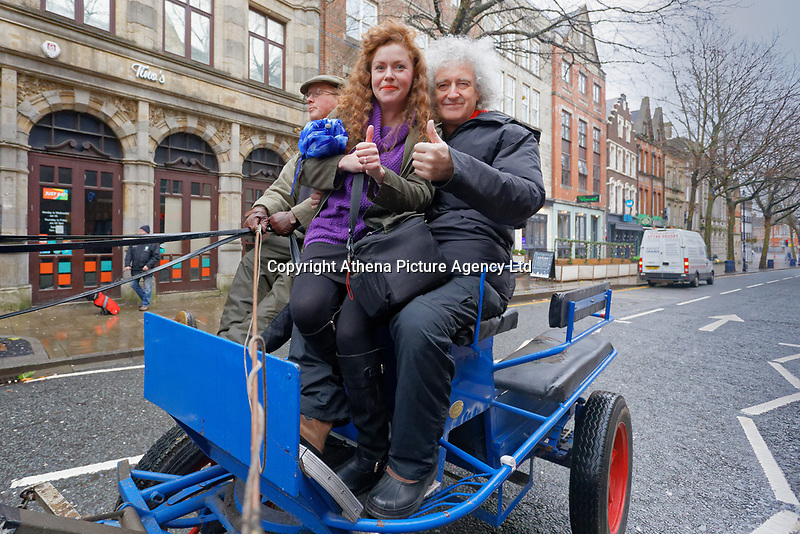 Pictured L-R: Grace Powell and Brian May. Thursday 26 December 2019<br /> Re: Guitarist Brian May of Queen has joined the Boxing Day Hunt in Wind Street, Swansea, Wales, UK.