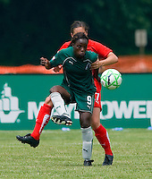 St. Louis Athletica forward Enoila Aluko (9) receives a pass in front of Washington Freedom defender/midfielder Ali Krieger (27) during a WPS match at Anheuser-Busch Soccer Park, in Fenton, MO, June 20 2009. Washington  won the match 1-0.