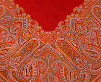 A vivid red and orange paisley is used as a table cover