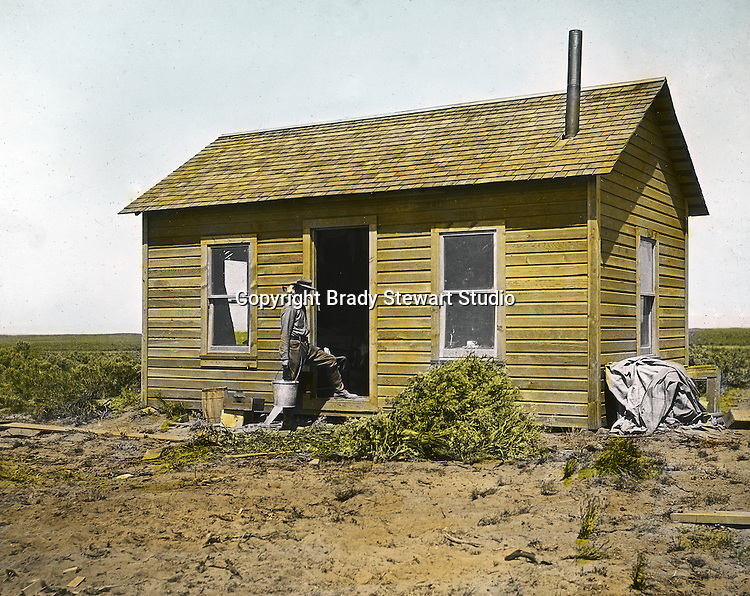 Jerome ID:  Brady Stewart repairing the farmhouse on the 160-acre estate.  Brady Stewart and three friends went to Idaho on a lark from 1909 thru early 1912.  As part of the Mondell Homestead Act, they received a grant of 160 acres north of the Snake River.  Brady Stewart photographed the adventures of farming along with the spectacular landscapes. To give family and friends a better feel for the adventure, he hand-color black and white negatives into full-color 3x4 lantern slides.  The Process:  He contacted a negative with another negative to create a positive slide.  He then selected a fine brush and colors and meticulously created full-color slides.