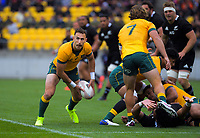 Australia's Nic White passes from a ruck during the Bledisloe Cup rugby union match between the New Zealand All Blacks and Australia Wallabies at Sky Stadium in Wellington, New Zealand on Sunday, 11 October 2020. Photo: Dave Lintott / lintottphoto.co.nz