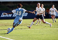 SAN DIEGO, CA - DECEMBER 02, 2012:  Crystal Dunn (19) of the University of North Carolina swings the ball past Whitney Church (17) of Penn State University during the NCAA 2012 women's college championship match, at Torero Stadium, in San Diego, CA, on Sunday, December 02 2012. Carolina won 4-1.