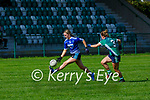 Fodhla Houlihan Laune Rangers  solos past Kate McCarthy Legion during their Junior A Championship game in Direen on Sunday