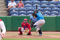 Tampa Tarpons Andres Chaparro (24) bats in front of catcher Juan Aparicio (44) and umpire Rainiero Valero during a game against the Clearwater Threshers on June 13, 2021 at BayCare Ballpark in Clearwater, Florida.  (Mike Janes/Four Seam Images)