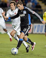 Bobby Convey (11) controls the ball against Ben Olsen. The San Jose Earthquakes tied DC United 2-2 at Buck Shaw Stadium in Santa Clara, California on July 25, 2009.