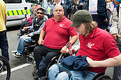 Spinal Injury Association members on The Hardest Hit  London march organised by the UK Disabled People's Council to protest at government cuts to disability benefits, allowances and services.