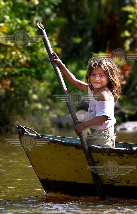 A girl of the Anu-Parajuana ethnic group paddles a canoe in the Sinamaica Lagoon.