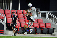 WASHINGTON, DC - NOVEMBER 8: Zachary Brault-Guillard #15 of Montreal Impact heads the ball against Edison Flores #10 of D.C. United during a game between Montreal Impact and D.C. United at Audi Field on November 8, 2020 in Washington, DC.