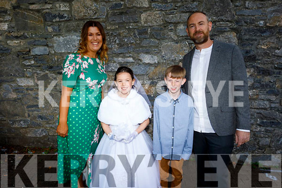 Freya Dennehy from Moyderwell NS receiving her First Holy Communion on Saturday with her parents Ger and Mary Dennehy and brother Keelan Dennehy in St Johns Church.