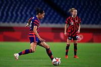 SAITAMA, JAPAN - JULY 24: Christen Press #11 of the United States passes the ball during a game between New Zealand and USWNT at Saitama Stadium on July 24, 2021 in Saitama, Japan.