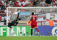 Trinidad goalkeeper Shaka Hislop looks back to see Peter Crouch's (not pictured) shot hit the back of the net for England's first goal. England defeated Trinidad & Tobago 2-0 in their FIFA World Cup group B match at Franken-Stadion, Nuremberg, Germany, June 15 2006.