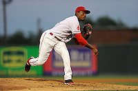 Pitcher Myles Smith (21) of the Greenville Drive delivers a pitch in a game against the Greensboro Grasshoppers on Wednesday, May 7, 2014, at Fluor Field at the West End in Greenville, South Carolina. Greenville won, 12-8. (Tom Priddy/Four Seam Images)
