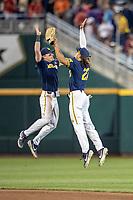 zMichigan Wolverines shortstop Jack Blomgren (2) celebrates with teammate Jordan Brewer (22) after beating the Florida State Seminoles at the NCAA College World Series on June 17, 2019 at TD Ameritrade Park in Omaha, Nebraska. Michigan defeated Florida State 2-0. (Andrew Woolley/Four Seam Images)