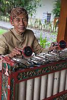 Borobudur, Java, Indonesia.  Xylophone Player.
