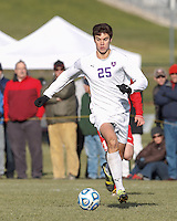 Amherst forward Greg Singer (25) brings the ball forward.  NCAA Division III Sectionals. In double-overtime, Amherst College (white) defeated St. Lawrence University (red), 2-1, on Hitchcock Field at Amherst College on November 23, 2013.