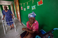 Haiti, Gros-Morne. Women in old person's community home.