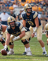 Pitt center Jimmy Morrissey and quarterback Kenny Pickett look for signals from the sideline. The Pitt Panthers football team defeated the Albany Great Danes 33-7 on September 01, 2018 at Heinz Field, Pittsburgh, Pennsylvania.