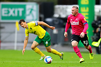 3rd October 2020; Carrow Road, Norwich, Norfolk, England, English Football League Championship Football, Norwich versus Derby; Wayne Rooney of Derby County takes on Christoph Zimmermann of Norwich City