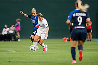 TACOMA, WA - JULY 31: Savannah McCaskill #7 of Racing Louisville FC and Jessica Fishlock #10 of the OL Reign battle for the ball during a game between Racing Louisville FC and OL Reign at Cheney Stadium on July 31, 2021 in Tacoma, Washington.